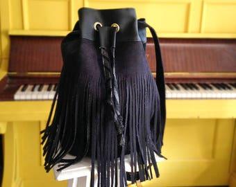 Black bi-material bucket bag with fringe