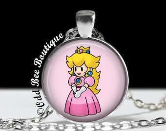 "Princess Peach Necklace - Mario Brothers Pendant - Nintendo Game Jewelry - Gamer Girl Accessory - Geekery Gift - 1"" Silver & Glass Pendant"