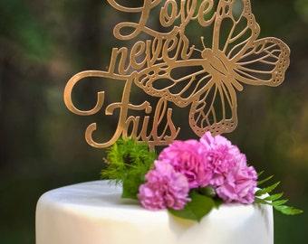 Love Never Fails Wedding Cake Topper