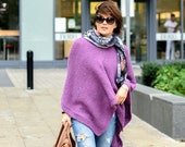Poncho cape hand knitted in alpaca wool.