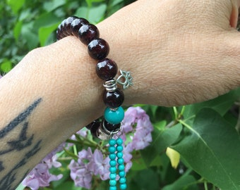 Lotus Light Mala Bracelet | Garnet | Turquoise | Mala Beads | Luxury Gemstones | Sterling Silver Lotus Charm | Passion | Courage | Energy