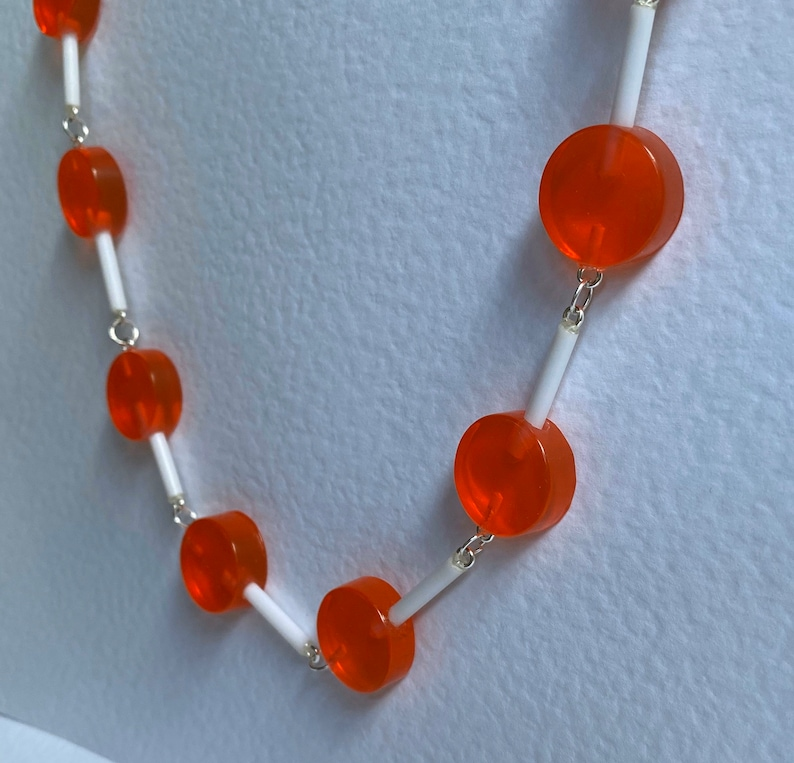Orange round  lollipop full chain Necklace 25 Inches long silver coloured chain