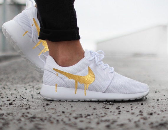 38a99c7769780 Items similar to Nike Roshe Run One White with Custom Gold Candy Drip  Swoosh Paint on Etsy