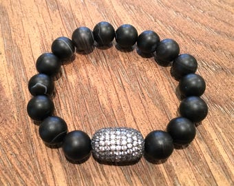 Black beaded stretch bracelet with a large crystal bead accent