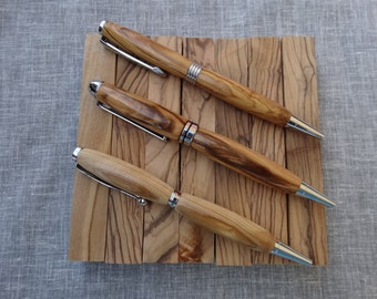 Olive wood hand turned pens.  Custom made from certified Bethlehem olive wood!