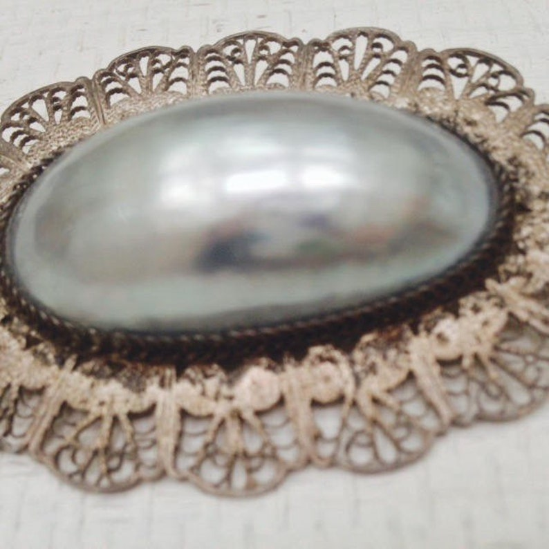 Antique Edwardian Romantic Rare Oversized Shimmering Mother of Pearl Brooch with Hand Wrought Silver Filigree Surround