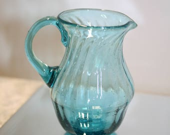 Wee aqua glass pitcher; blown glass; ribbed aqua creamer; pontil; applied handle; hand made; blue glass