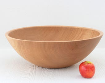Large wooden salad bowl, made out of solid cherry wood.