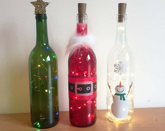 holiday wine bottle decorations with lights santa snowman christmas tree wine bottle decor wine bottle crafts holiday decorations