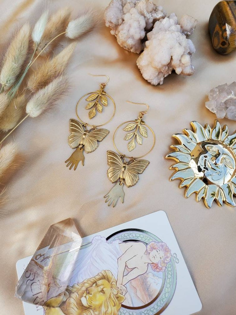 Gold Butterfly Nature Goddess Hoop Earrings Irene Gold Botanical Hand and Butterfly Hoop Earrings