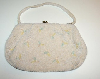 """Glass beaded bag. Vintage handbag embroidered white bead floral bag. 9"""" width, 6"""" tall. Covered with glass beads. Clean inside and out."""