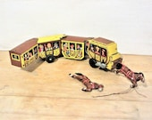 Vintage wind up tin toy. Overland Stage US Mail, features 4 cars pulled by 2 horses. Made in Japan by LineMar Toys. Has condition issues
