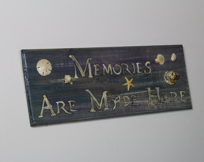 Memories Are Made Here - Handpainted one of a kind cypress wood sign with starfish, oyster shells, and assorted sea shells on front.