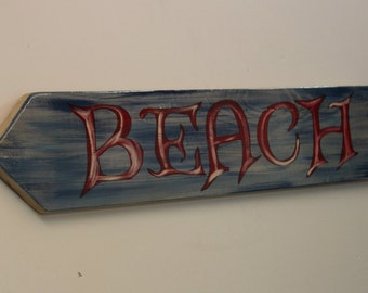 Beach- Directional cypress wood sign with high gloss 2 part epoxy finish.