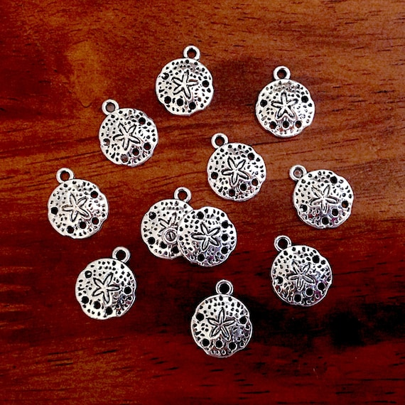 8 Shell charms antique silver tone FF367