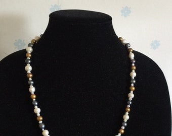 Fresh water pearls in black and white and gold.