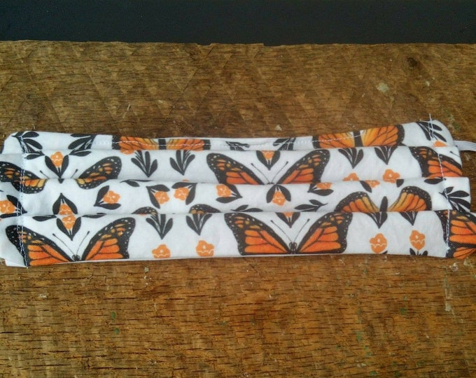 Adult Monarch butterfly face mask, Machine washable with elastic.