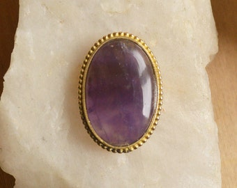 Large grooved oval amethyst cabochon set in brass. High grade, 54 ct crystal semi precious gemstone