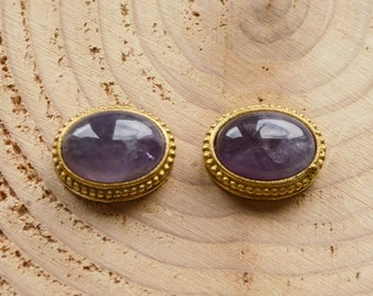 Grooved oval amethyst cabochon set in brass. High grade, 23 ct crystal semi precious gemstone