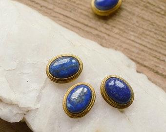 Grooved oval blue lapislazuli cabochon set in brass. High grade, 20 ct crystal semi precious gemstone