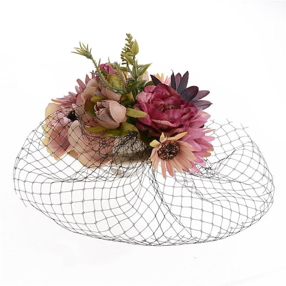 Wedding Guest Races Pink flower fascinator with black cage veil