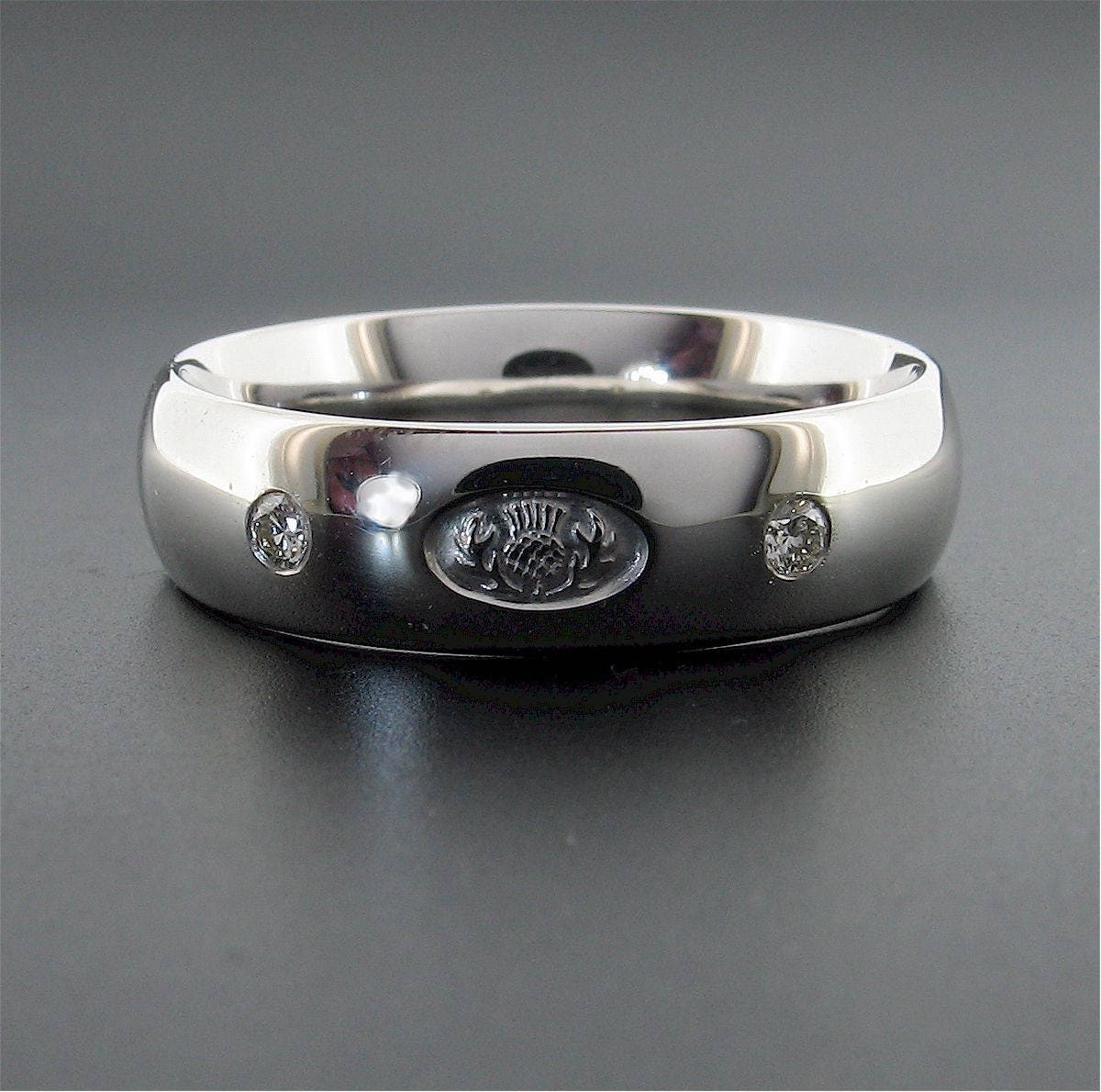 It is a photo of Scottish Thistle diamond wedding ring in white gold 50mm