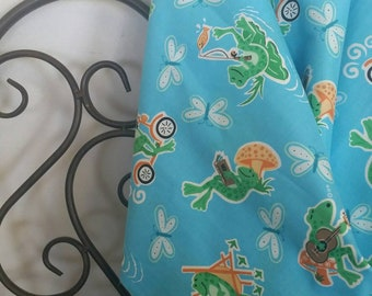 Fun Green Foggy Frogs 100 Percent Cotton on Blue Background Playing, Reading, Scootering, Crafting and Children's Fabric Free Shipping