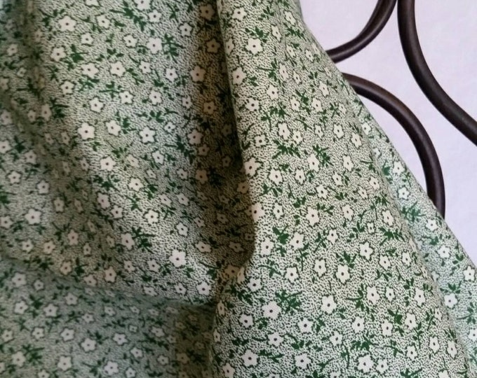 100 Percent Quilting Cotton Dainty White and Green Flowers on a  White Background