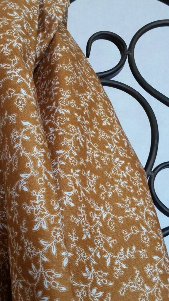 Free Shipping By The Yard 100 Percent Cotton Quilting Fabric With Small White Flowers on a Field of Dark Tan