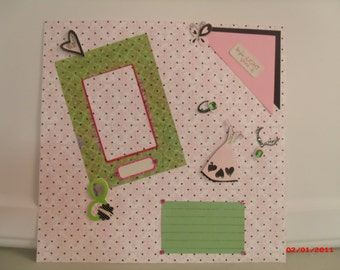 Pink & black polka dot with green accents. 12x12 pre-made scrapbook page