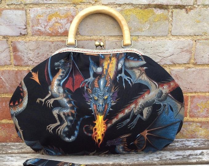 Featured listing image: Dragons fabric handbag purse shoulder bag wooden handle handmade kiss lock frame, strap or chain Alexander Henry Game of Thrones