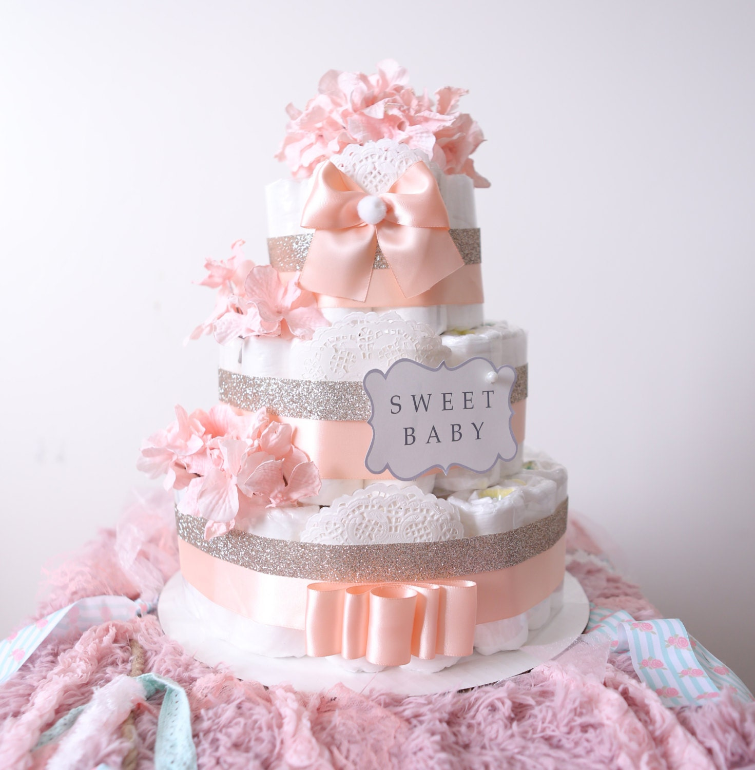 gold & blush pink diaper cake for baby girl / baby shower
