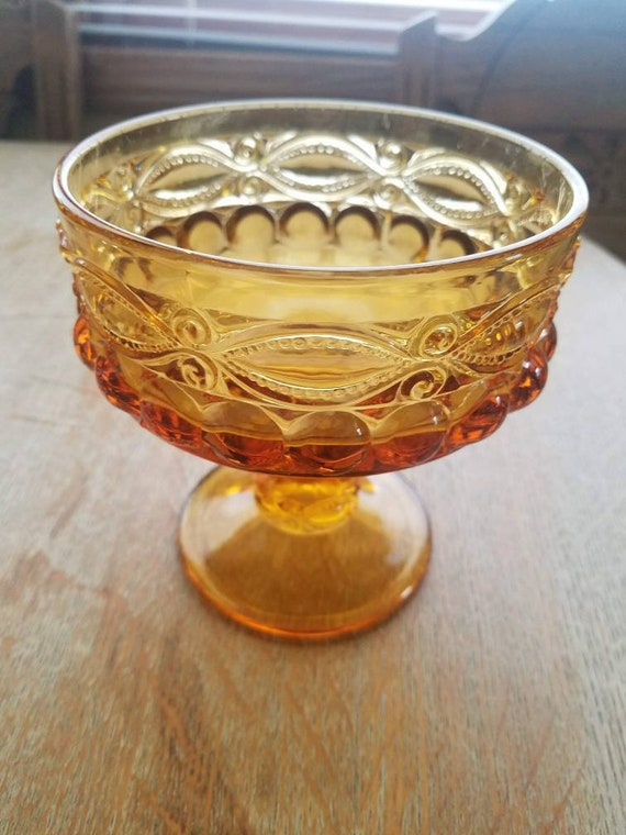 Amber glass pedestal dish candle holder or table centerpiece