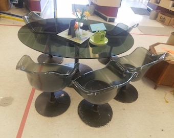 Table and five chairs in a tulip style probably Chromcraft but no markings MCM Lucite smoke black chairs