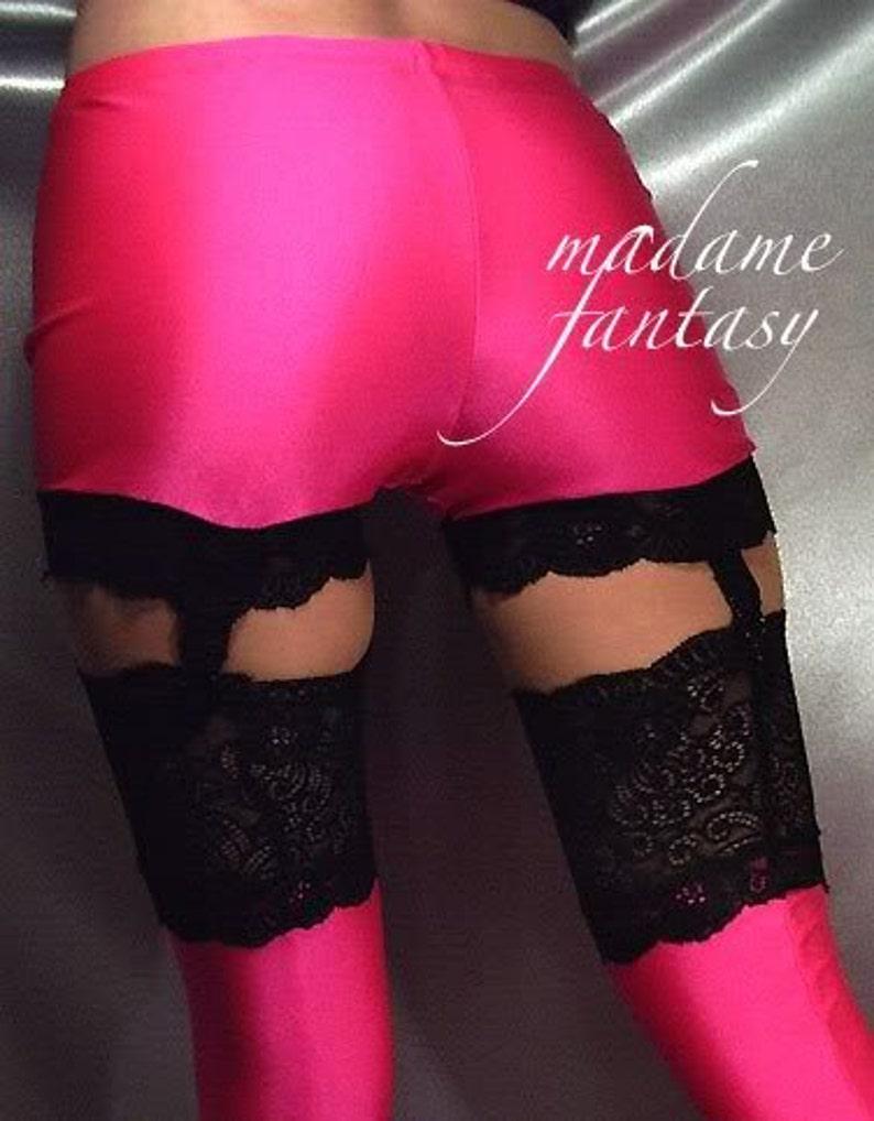 Shiny neon pink spandex suspender shorts hot pants black lace trim