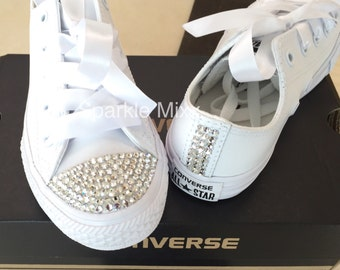 All White Converse with the toes and back strip crystallised and white  ribbon laces. Perfect bride or bridesmaid shoe. Adult sizes f47ab1c8ad35