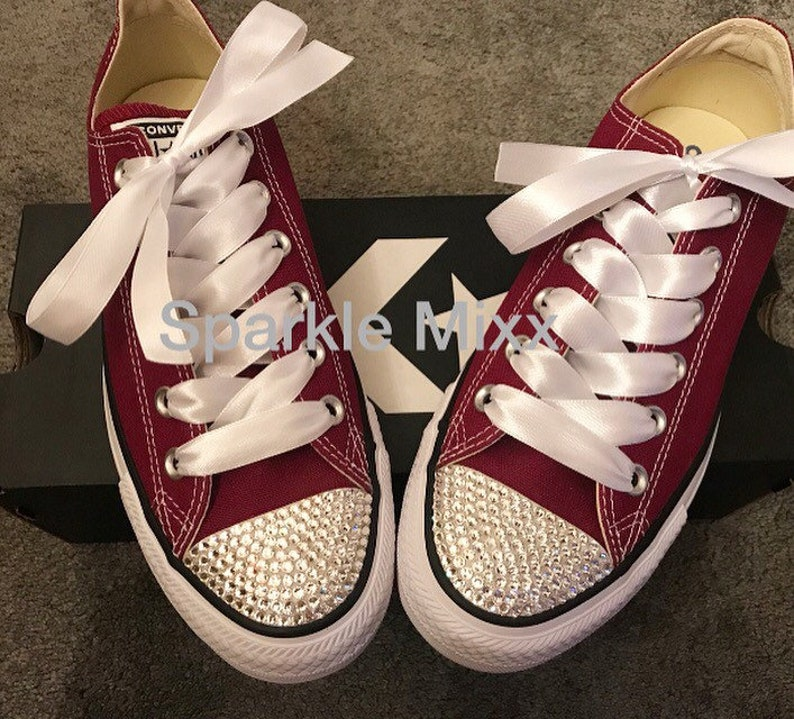 d652c4313d34 Maroon Converse bedazzled with crystals on the toes and white
