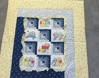 Cute cat/dog baby quilt in yellow and blue.