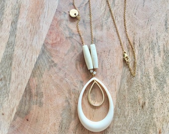 Ivory necklace and leather