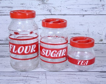 Vintage Cove Glass Canister Set of 3 Clear Embossed Floral Design Red & White Graphics Plastic Top Kitchen Pantry Barware Jar Made In Italy