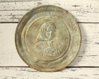 Vintage Solid Brass Wall Plate Hanging Old Woman With Head Scarf Embossed in the Piece Great Patina Oxidized Green Hook For Hanging 10""