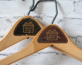 Vintage Set of 2 Hangers Natural Color Solid Wood With Metal Hook & Bar Eagle Clothes Coats Advertising Brown Black Labels Hollywood Regency