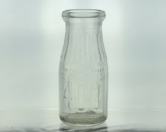 Vintage 400 Dairy Glass Milk Bottle Clear Bottle 7 Fluid Ounces Sealed Graphics Writing Container Registered US Patent Office Flower Vase