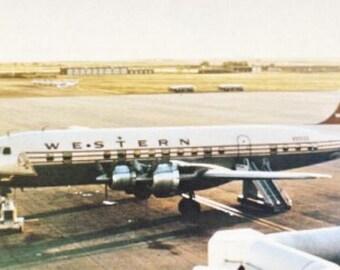 Aerial Transit Douglas DC-6C A136