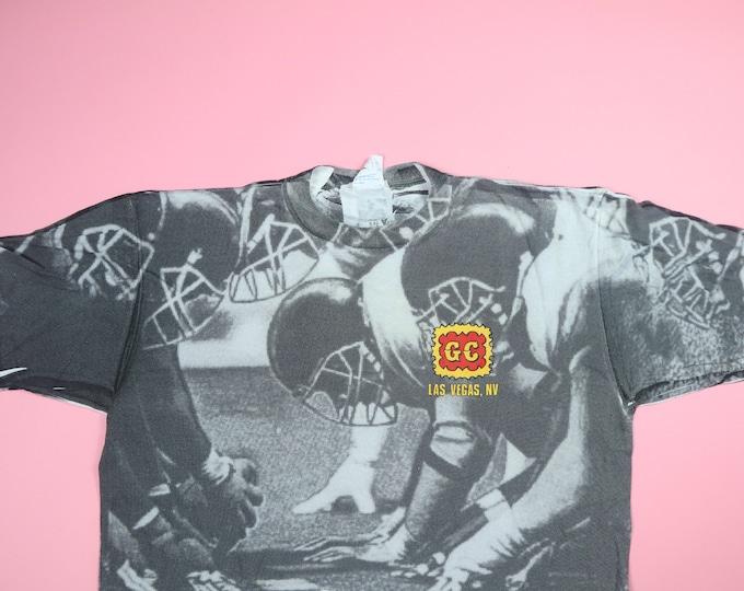 Gold Coast Las Vegas all over football print 1990s vintage Tshirt