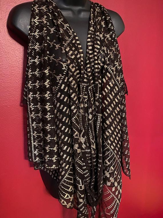 Strike a pose, antique assuit shawl with an attitu
