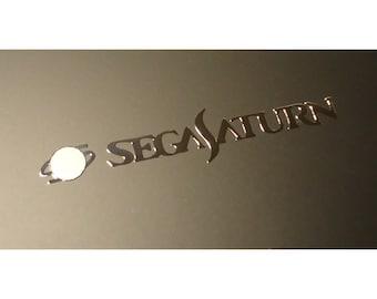 Sega Saturn Label / Aufkleber / Sticker / Badge / Logo 60mm x 11mm [178]