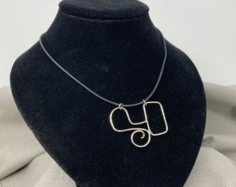 Unique silver wire symbol necklace on black rubber cord, ONLY ONE AVAILABLE, free shipping
