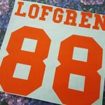 Name and Number Iron On Decal - Heat Transfer Vinyl - DIY Sports Gear - Matte or Glitter - Family Shirt -  Baby - Kid - Teen - Adult
