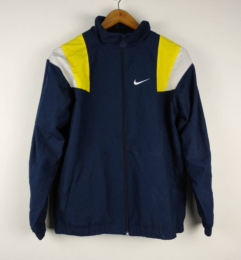 9147f7a67ca7 Vintage 90s Nike Swoosh Streetwear Windbreaker Hoodie Jacket